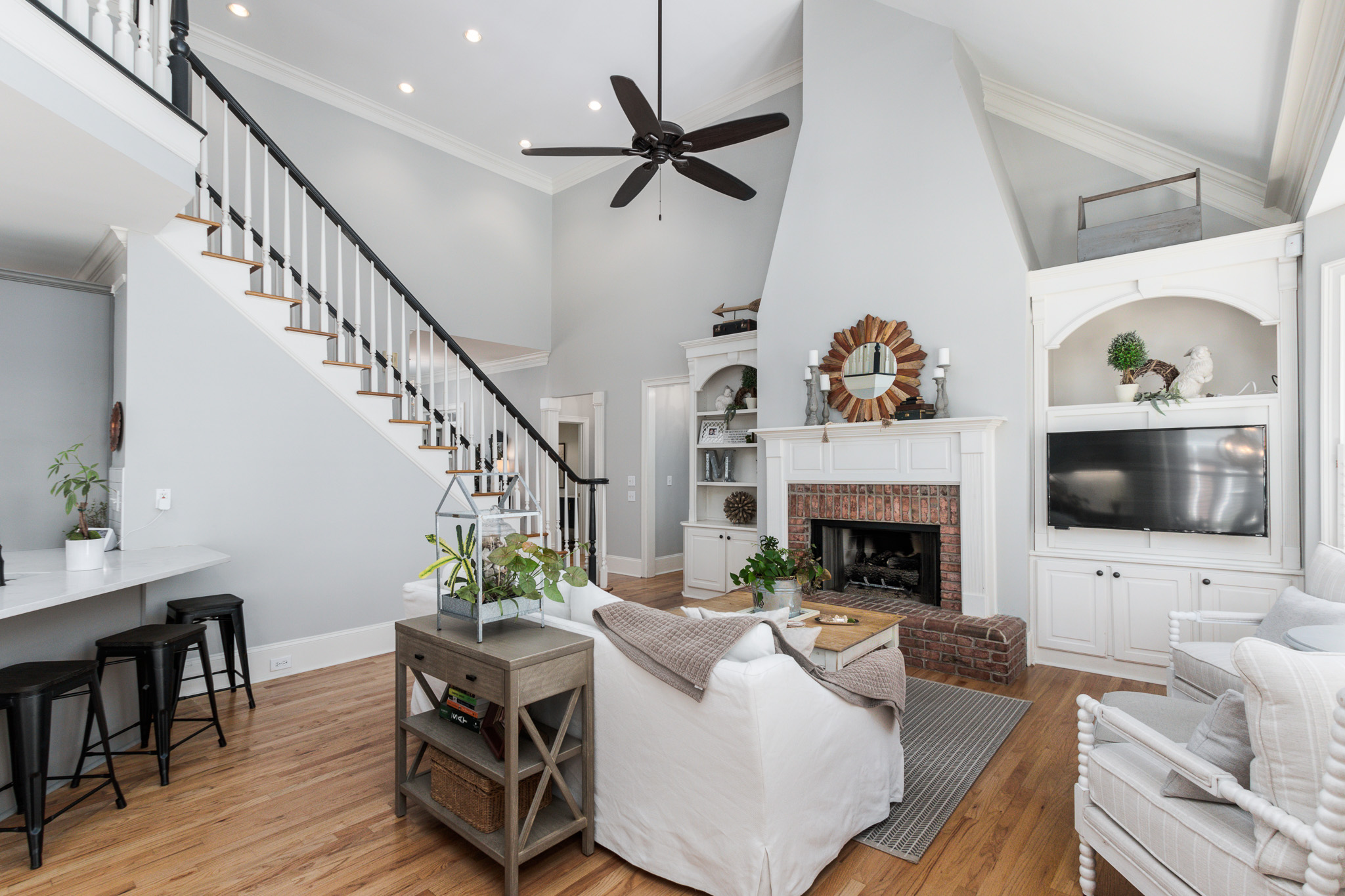 Bright family room with gray walls, white trim, and contemporary style.